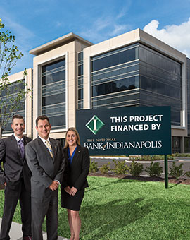 three national bank of indianapolis employees standing in front of a financed project